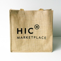 Roomy with a wide base, this Jute Bag is perfect for grocery runs and picnics!